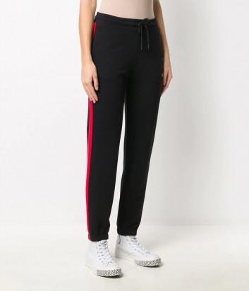 Спортивные брюки MSGM 2941MDP67 черные с красными лампасами
