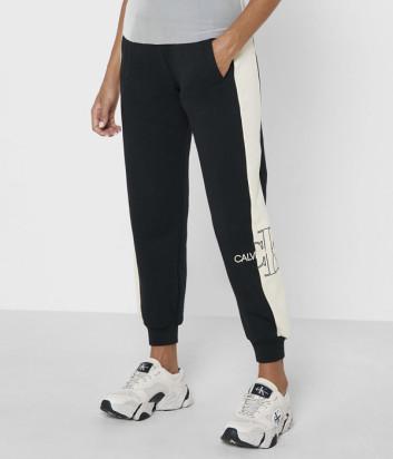Спортивные брюки CALVIN KLEIN Jeans J20J217132 черные с бежевыми лампасами