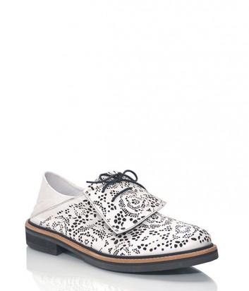 Кожаные туфли-броги Alexander McQueen с перфорацией черно-белые
